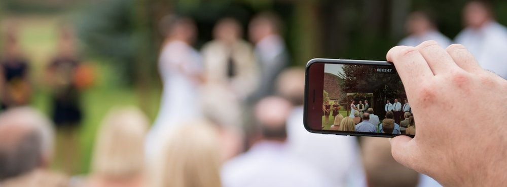 wes fisher photography phones at wedding .jpg