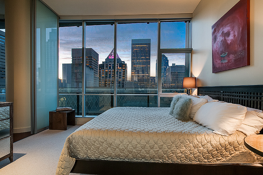 Manhattan-like views of Seattle - An expansive wall of windows showcases the beautiful city and sound below - perched perfectly for privacy just above the iconic Rem Koolhaus designed Library. Enjoy Manhattan-like views of Seattle's skyline, from the Olympics to the Puget Sound. The oversized master suite is a quiet, relaxing space to unwind at end of the day and a custom designed wallbed drops out into the office for guests.