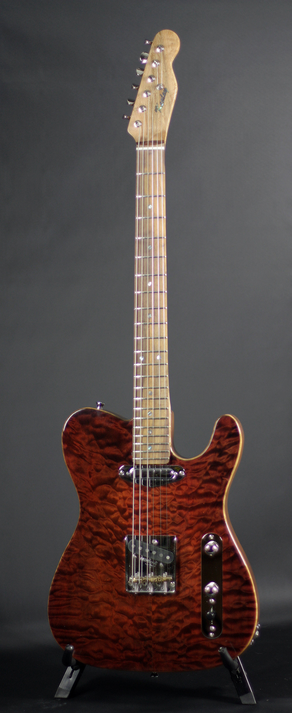 "T-Style  - SOLDThree Piece Walnut BodyHighly Figured Quilted Maple TopTwo Texas Special PickupsWilkinson Chrome BridgeKluson Chrome TunersIndian Rosewood Fretboard 7.25 RadiusBirdseye Maple NeckAbalone Inlay25.5"" ScaleMedium Jumbo FretsNitro Lacquer FinishTweed Hardshell Case"