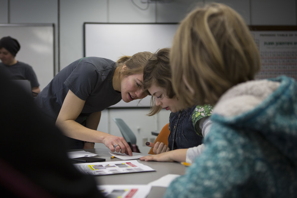 Part of Dana Reuter's duties with the UO Women in Graduate Science is to plan and lead outreach events to encourage young girls to show interest in science. Reuter shows a group of fourth graders how to analyze handwriting at a girls forensic science workshop.
