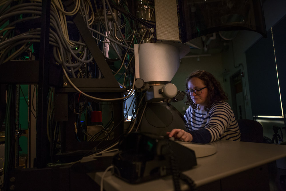 Alice Greenberg, physics Ph.D. candidate at the University of Oregon spends a Saturday afternoon in the dark basement of Huestis Hall in the CAMCOR lab studying electrons. Greenberg co-founded UO Women in Physics.