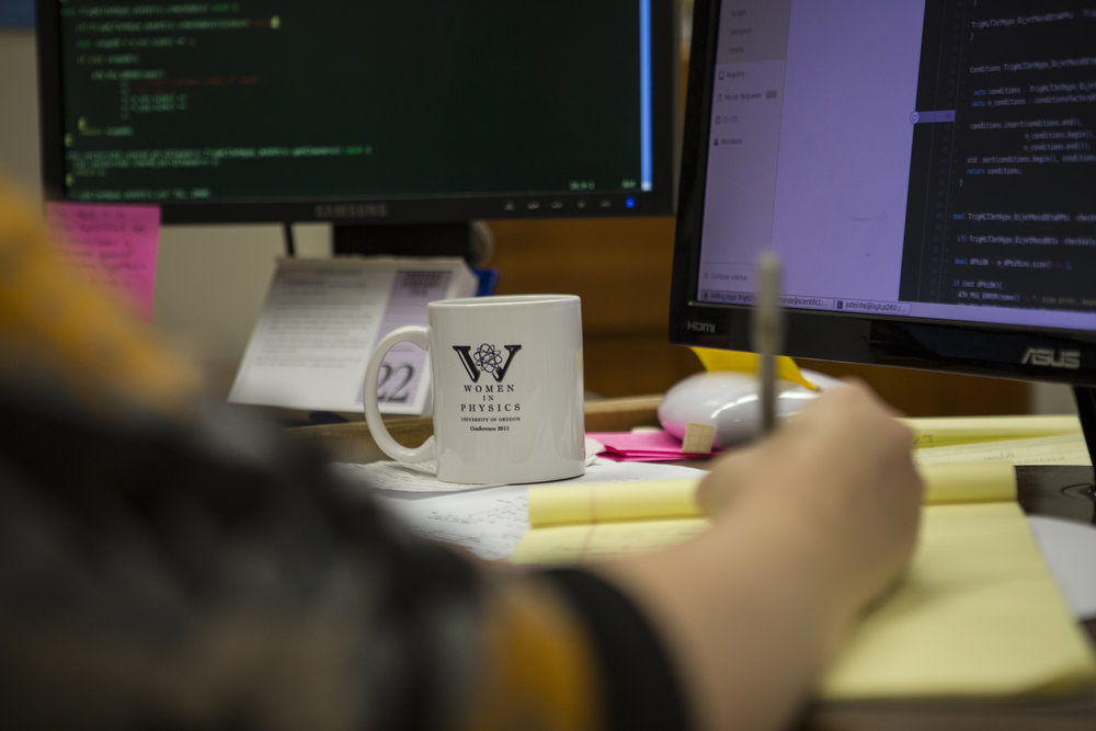 Steinhebel's Women in Physics mug sits half-full on her desk. She co-founded the group with Greenberg and Zappitelli after attended a Pacific Northwest women in science retreat where they were three of the five physicists in attendance.