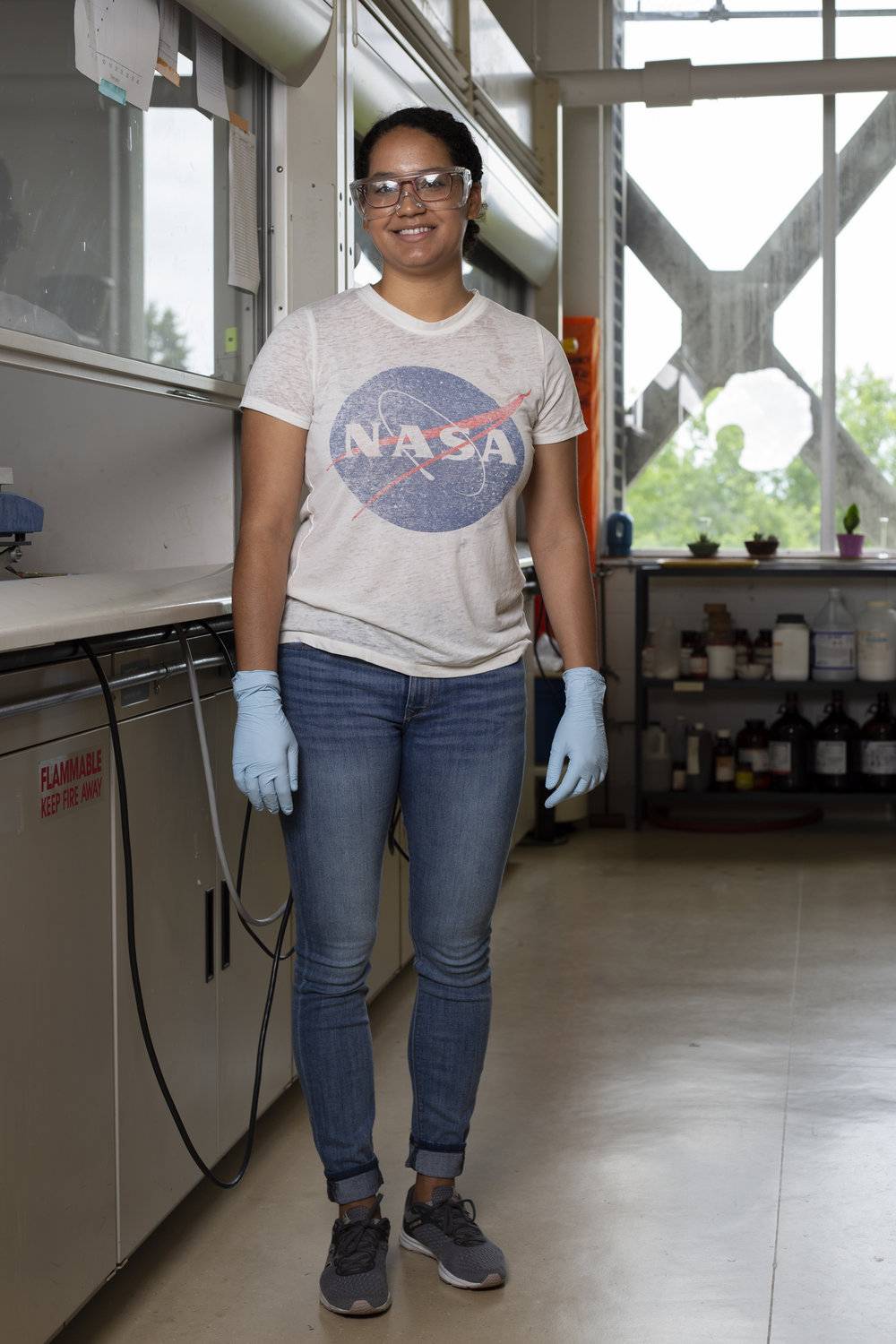 """Jaclyn Kellon is a fourth-year chemistry Ph.D. and president of Communities for Minorities in STEM. After earning her degree, Kellon wants to work for the government using science to inform policy decisions.  """"I knew as a woman of color I would need a Ph.D. to get any level of respect in that world, so I decided to go to graduate school,"""" she said.  Currently she researches the electronic properties and toxicity of metal oxide nanoparticles to use in electronic devices, like your cellphone."""