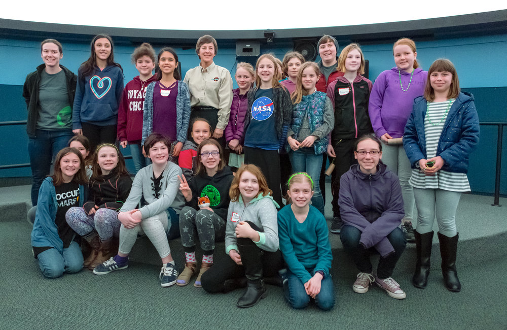Astronaut Wendy Lawrence, center top row, stands with the Girls' Science Adventure workshop participants. Lawrence was invited by UO Women in Graduate Science to encourage young girls to stay excited about science.