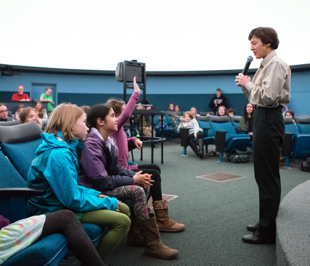 Astronaut Wendy Lawrence answers questions from the Girls' Science Adventure workshop participants in the Eugene Science Center planetarium.