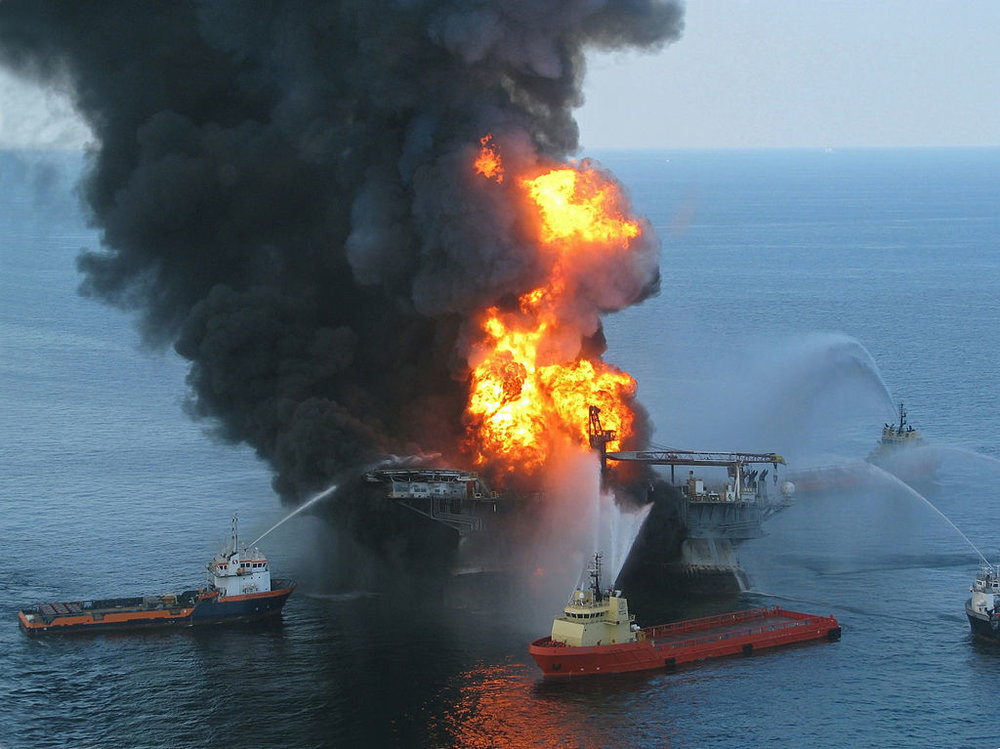 Deepwater Horizon Offshore drilling unit burning during the 2010 BP Oil Spill. Public Domain image courtesy of the United States Coast Guard.