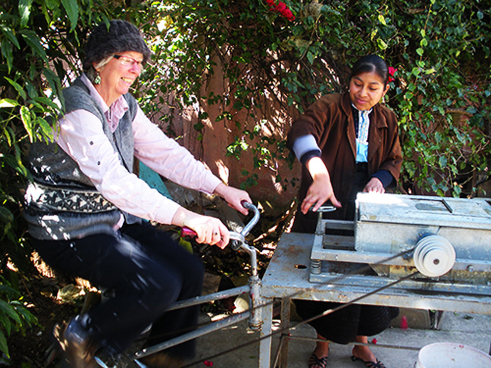 Using a pedal powered beater, paper is made from wild plants and recycled agricultural and industrial waste.