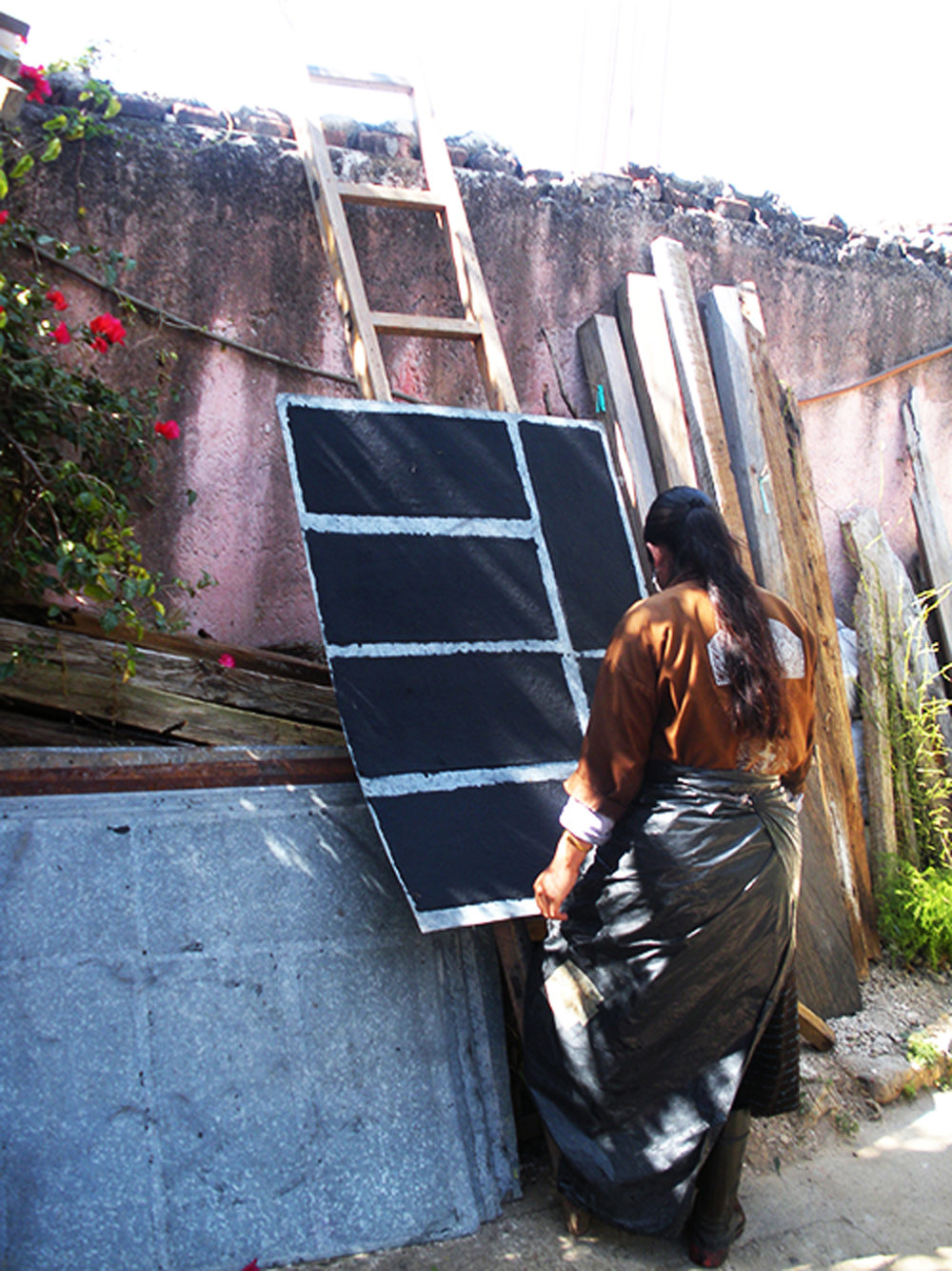 Wet paper is 'couched' onto metal sheets which are then hauled onto the flat roof to dry in the hot Mexican sun.