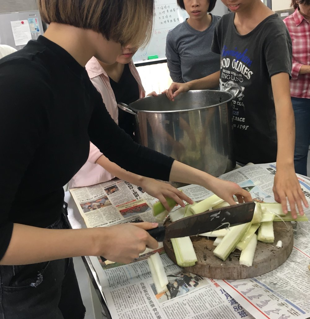Students chopping the banana plant before cooking