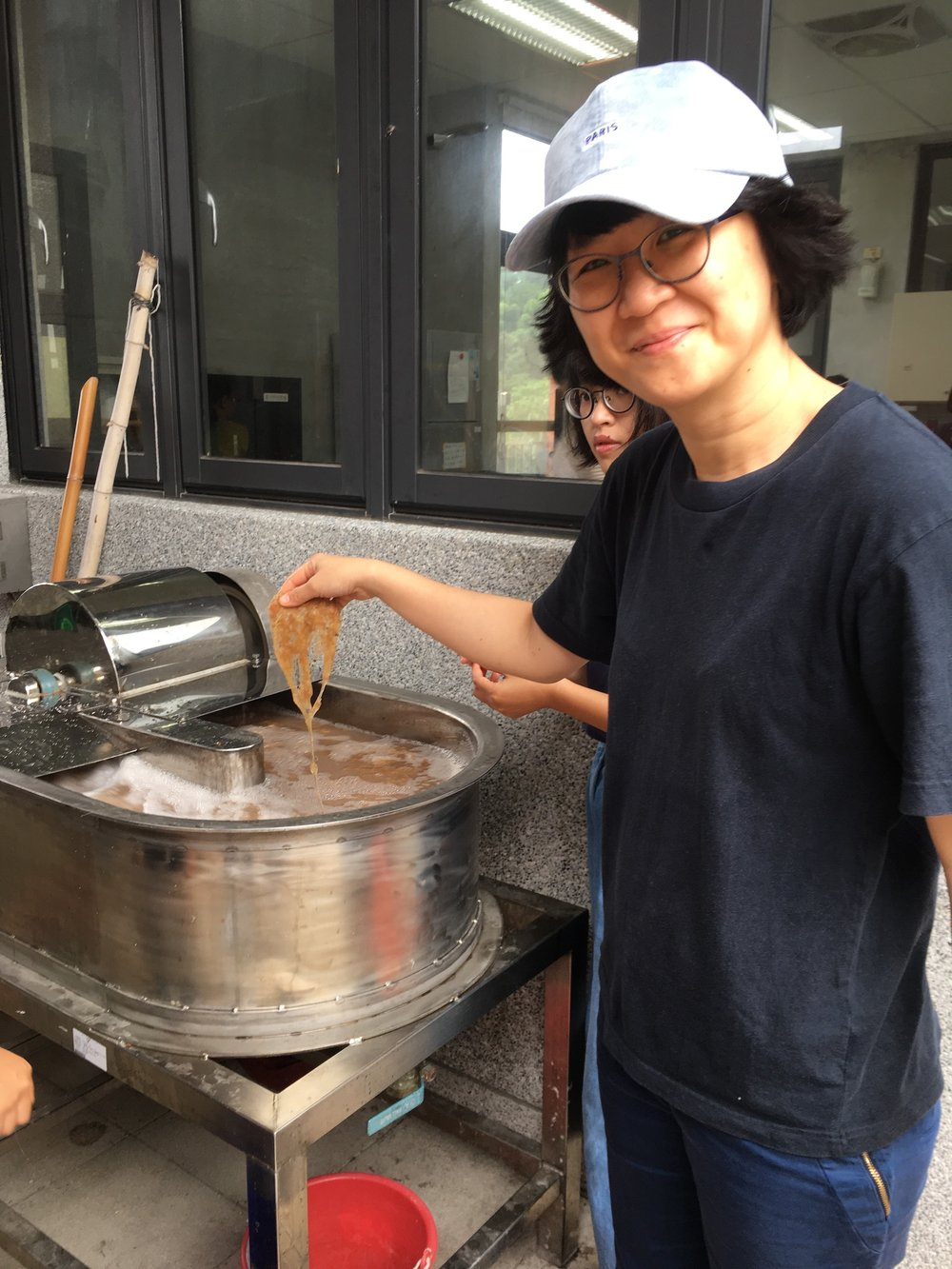 Assistant Professor from the Graduate Institute of Applied Arts, Pei-Shan Wu checks the progress of the beaten banana fibre in the  beater.