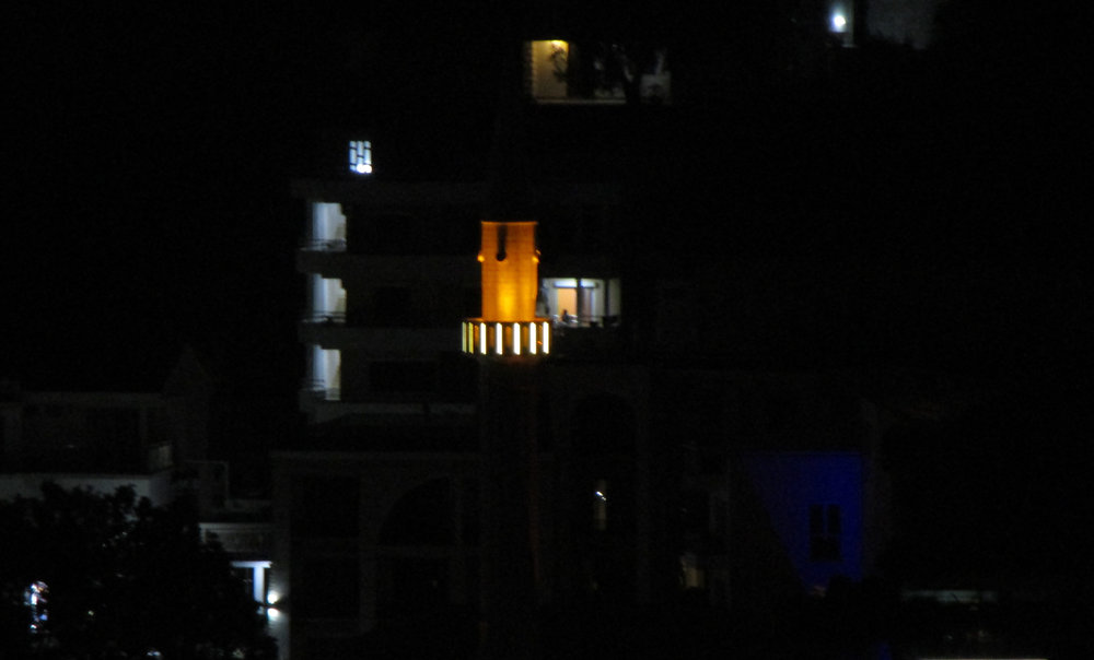 Sailor's Mosque at night, close up of the lit up minaret.