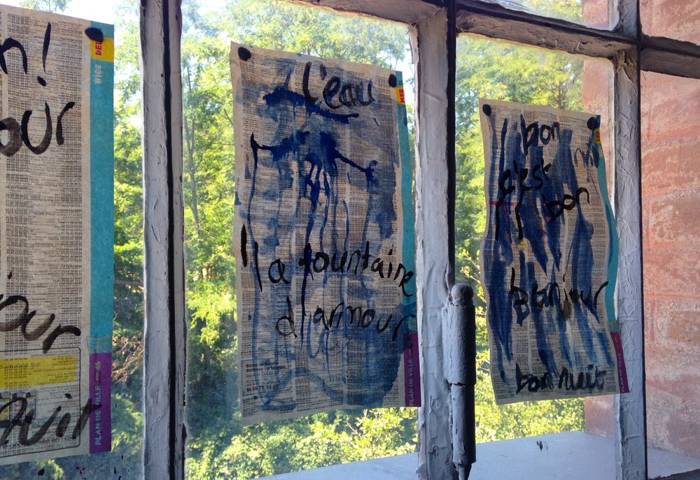 Words on the window. I only just noticed I spelt la fontaine wrong. Quel dommage!
