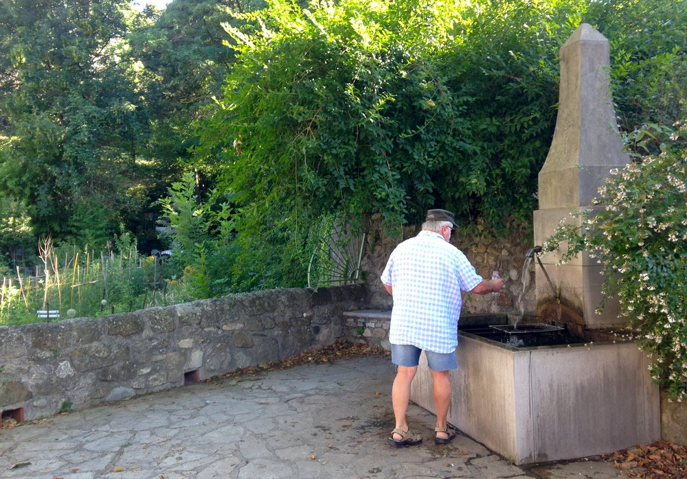 Filling up the water bottles from la fontaine d'amour