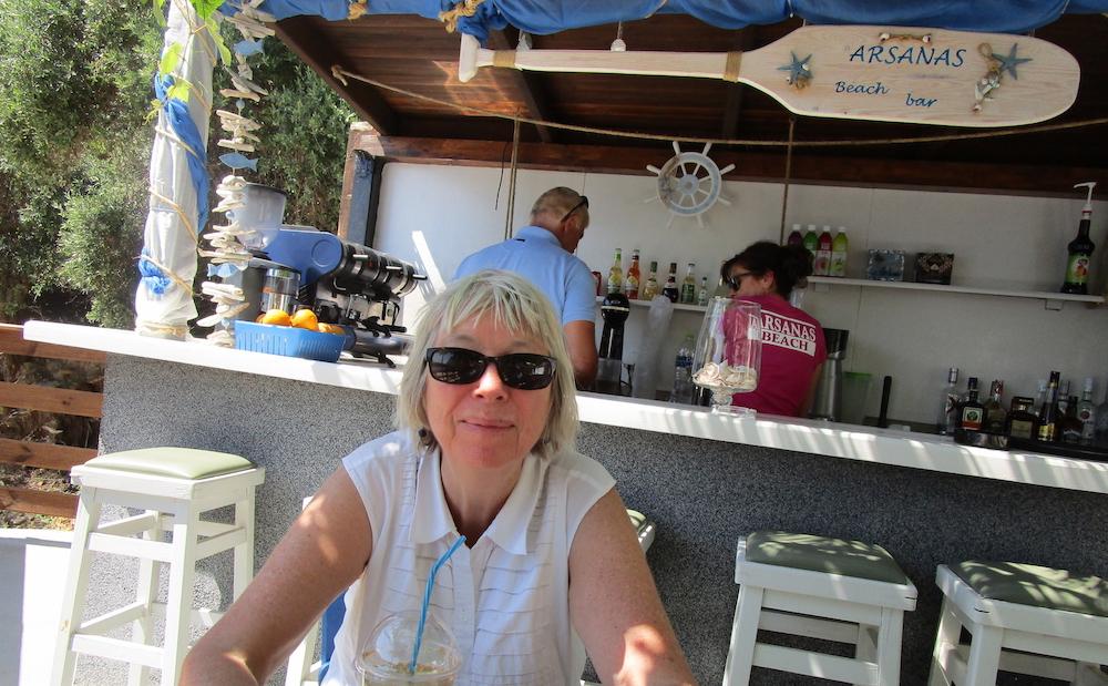 In a café somewhere near a beach (anywhere)
