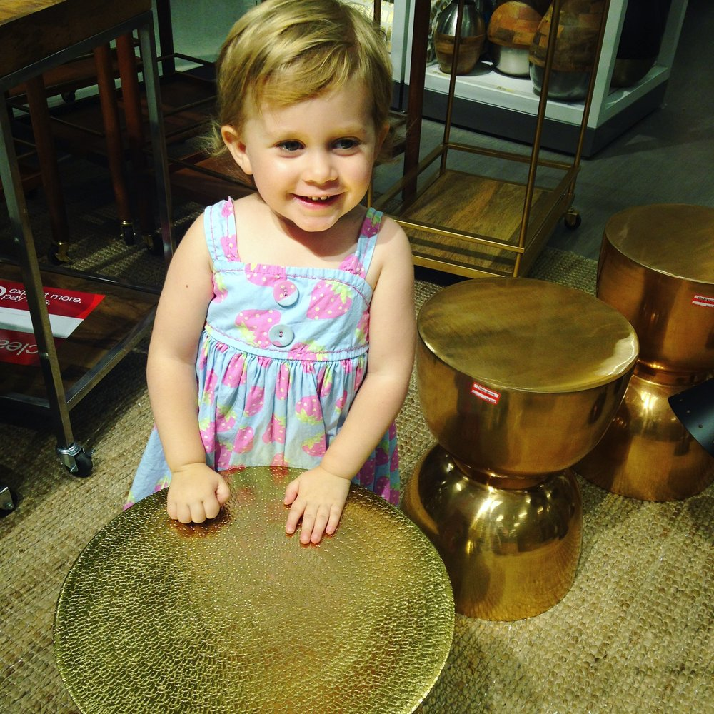 "Penny playing impromptu side-table ""drums"" on clearance at Target, her favorite store in the world."