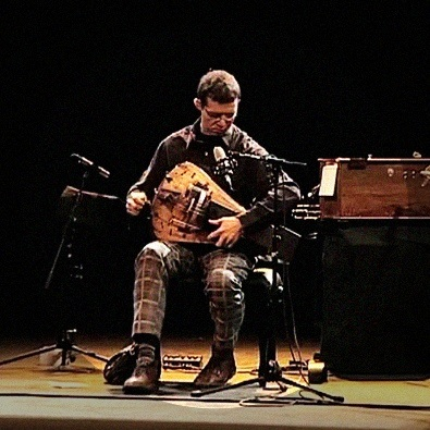 Matthias Loibner making sounds with plaid pants and astounding virtuosity.