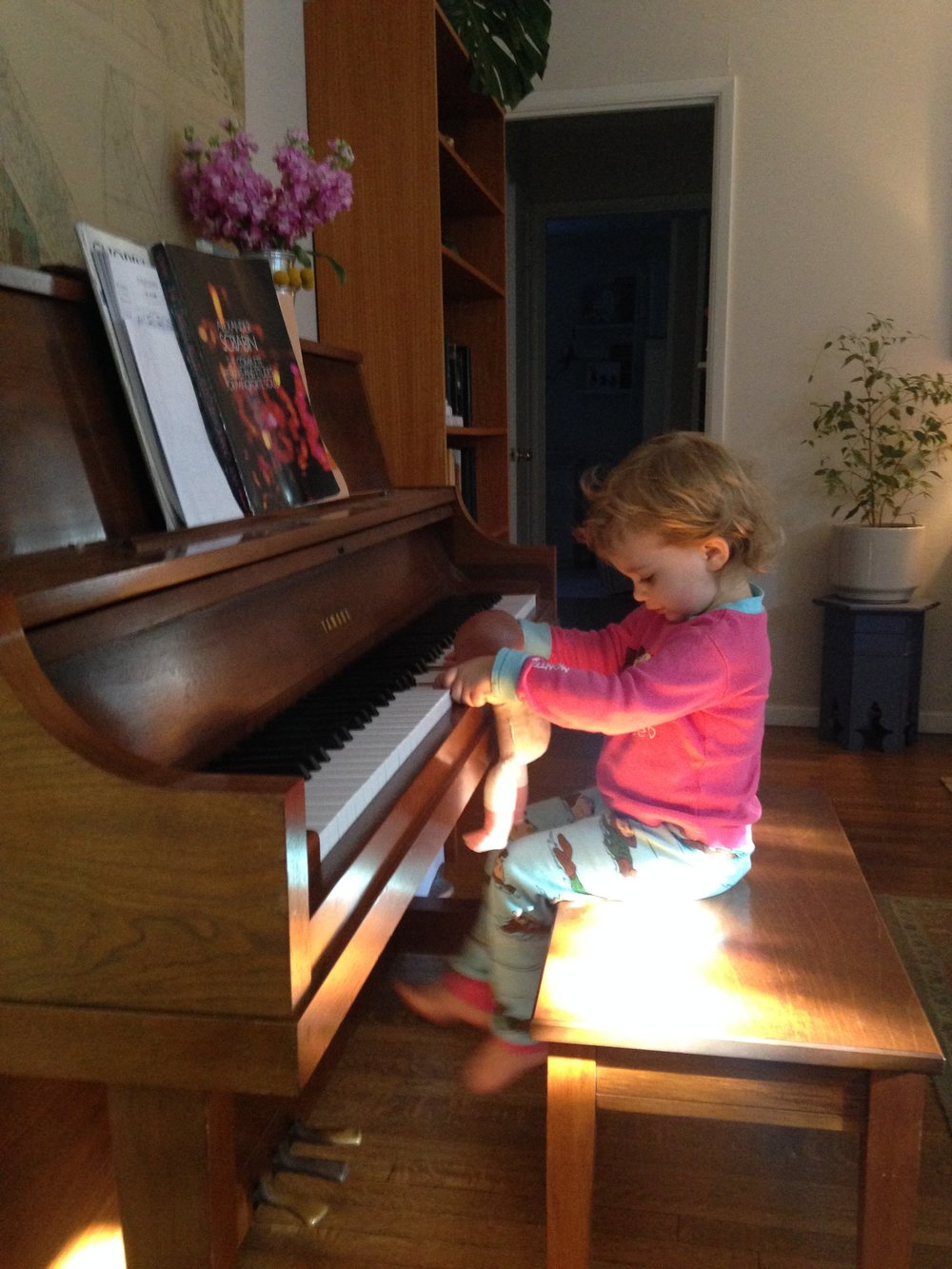 My resilient first-born, Penelope, with her own baby at the piano bench. Scriabin sheet music on the stand.