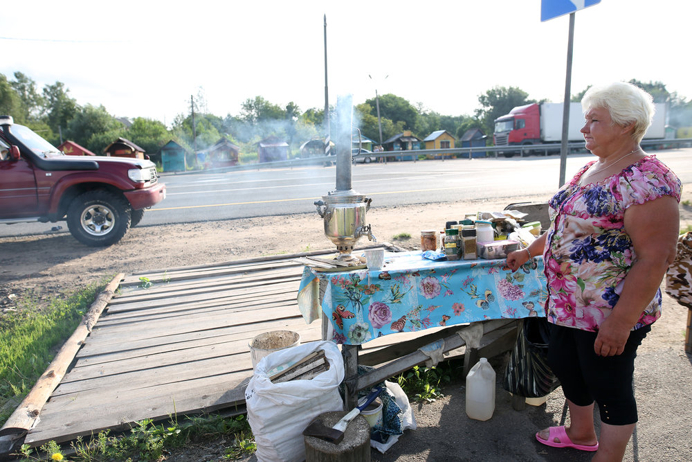 Babuska selling tea on road between St-Petersburg and Moscow