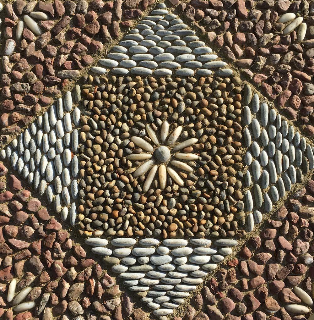Pebble mosaic. Designed and constructed by David James, Olicana Mosaics, Ilkley.