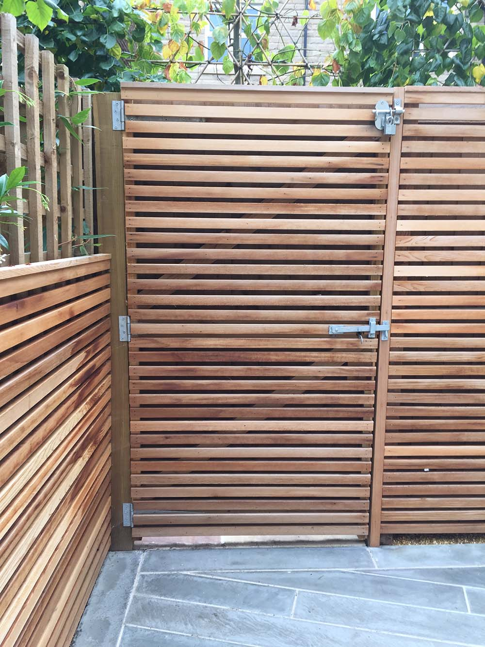 Gate and cedar slat screen.