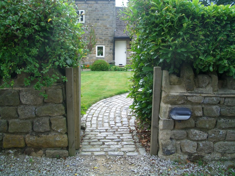 The entrance gate - a glimpse into the garden.