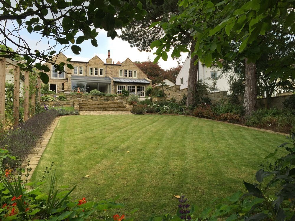 Converted coach house with a generous sunny lawn.