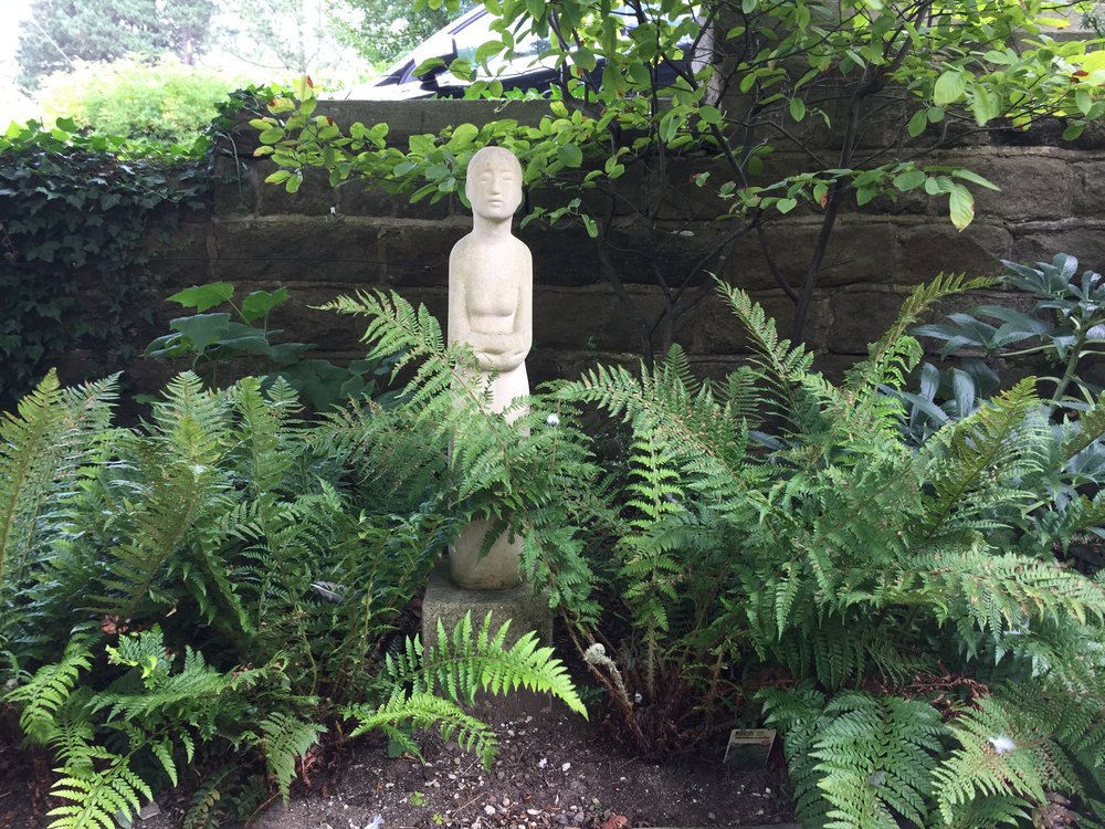 Meridian stone figure supplied by sculptor, Rowena Beatty.