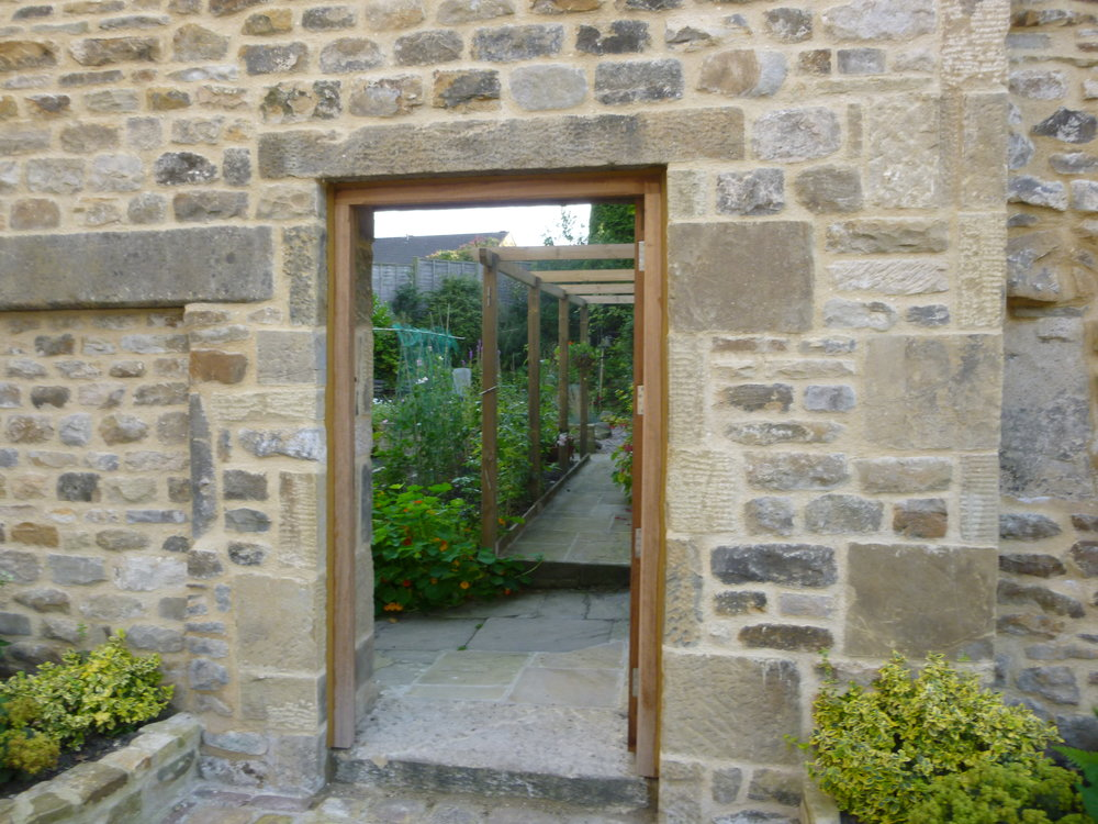 Looking through the gate into the back garden and vegetable plot.