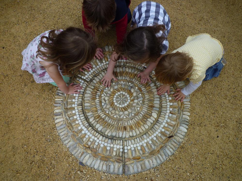 Nursery children exploring the 'Heaven Mosaic' by David James, Olicana Mosaics.