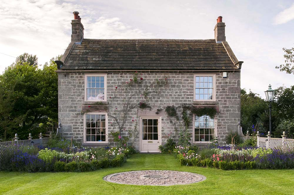 The double fronted cottage is enhanced by the new symmetrical garden layout.