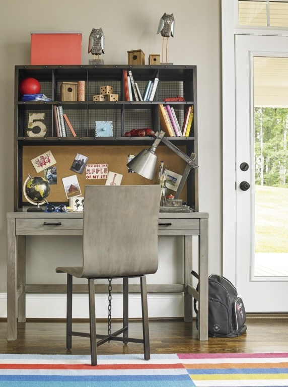 Scrimmage Desk and Hutch - If you're short on space a desk with hutch is the perfect combination. This provides a working surface space, drawers for storage, a bulletin board for posting photos, and shelving for storing all the things!The matching Scrimmage desk chair completes the look and is also in the greystone finish.