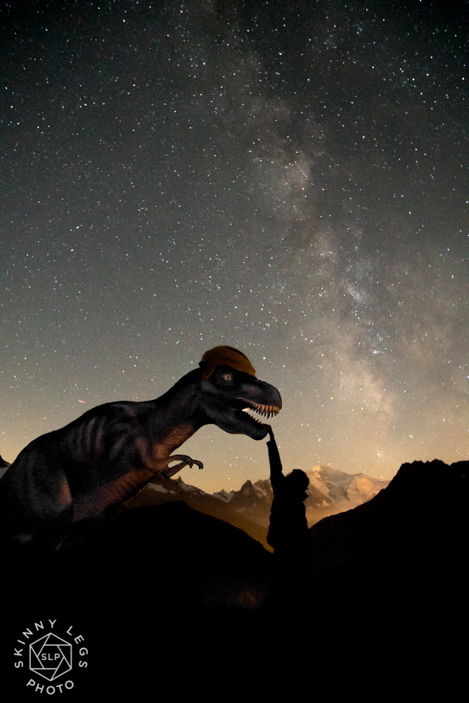 The T-Rex is real, not Photo Shopped in! There are Dinosaur foot prints a short walk from the Emosson Dam in Switzerland so there is a pretty life like looking T-Rex up there, a little creepy in the dark... The Tour de France also rode up the the dam in 2016 so of course they put a yellow bike helmet on his head!  This image is a 3.2 second exposure with an aperture of f2 and an ISO of 8000. Taken at 2330 on the 12th August 2017, the day of the Perseid Meteor shower.