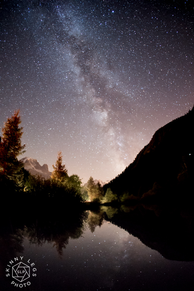 This image was taken at the Col du Montet showing a reflection of the Milkyway with the Aiguille Verte and Les Drus framed between two trees. The road is the other side of the lake giving a great back lit effect to the trees. Shot with a 20 second exposure at f2 with an ISO of 8000 at 2250 on the 20th August 2017.