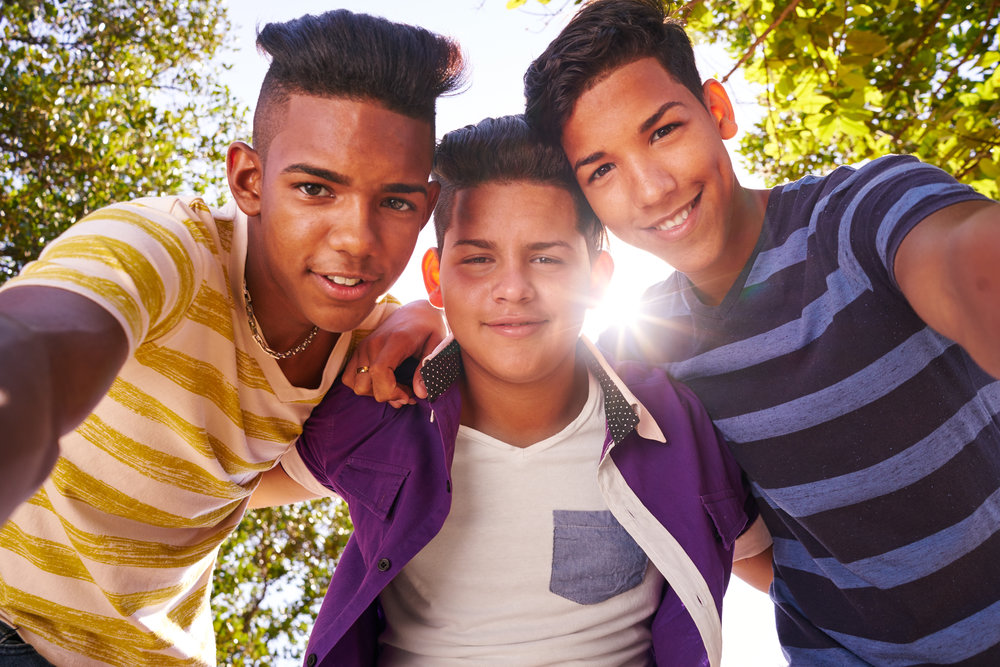 multiethnic-group-of-teenagers-embracing-smiling-P6TC66G.jpg