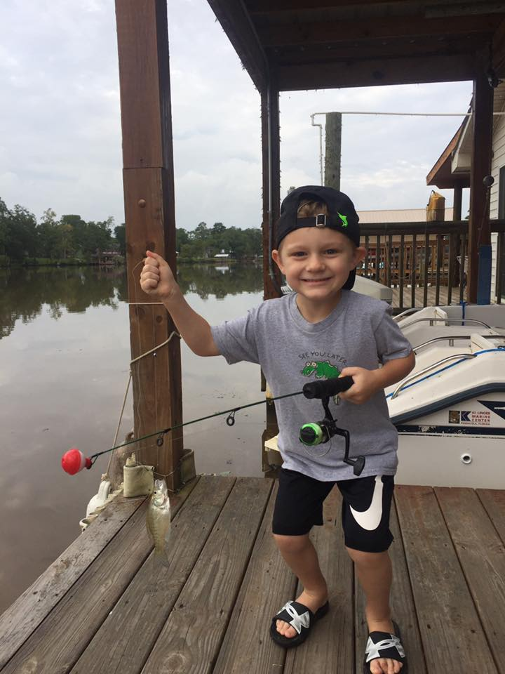 Future fisherman Mason House of Crestview caught and released this small perch on Gantt Lake June 10.