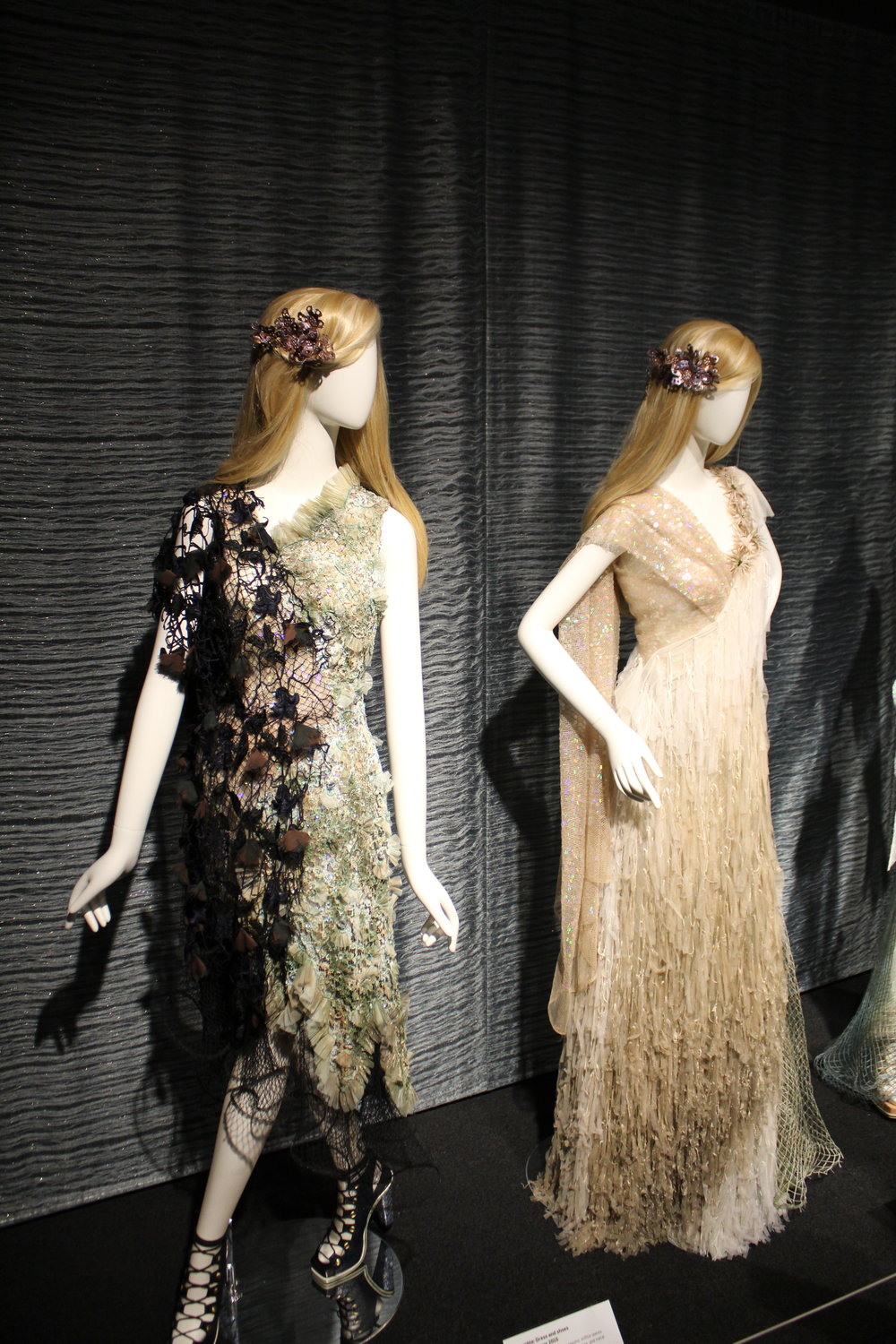 I enjoy the dramatic detail of each of these dresses. From the fish neck fabric to the feathers, I think each dress makes a bold statement on their own.