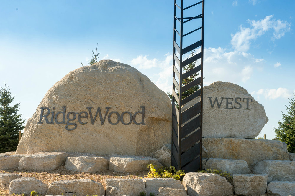RidgeWood West is a new community located within Charleswood in southwest Winnipeg. - This community will offer a diverse range of home styles in a beautiful landscape of wetlands, native grasses, and trails.