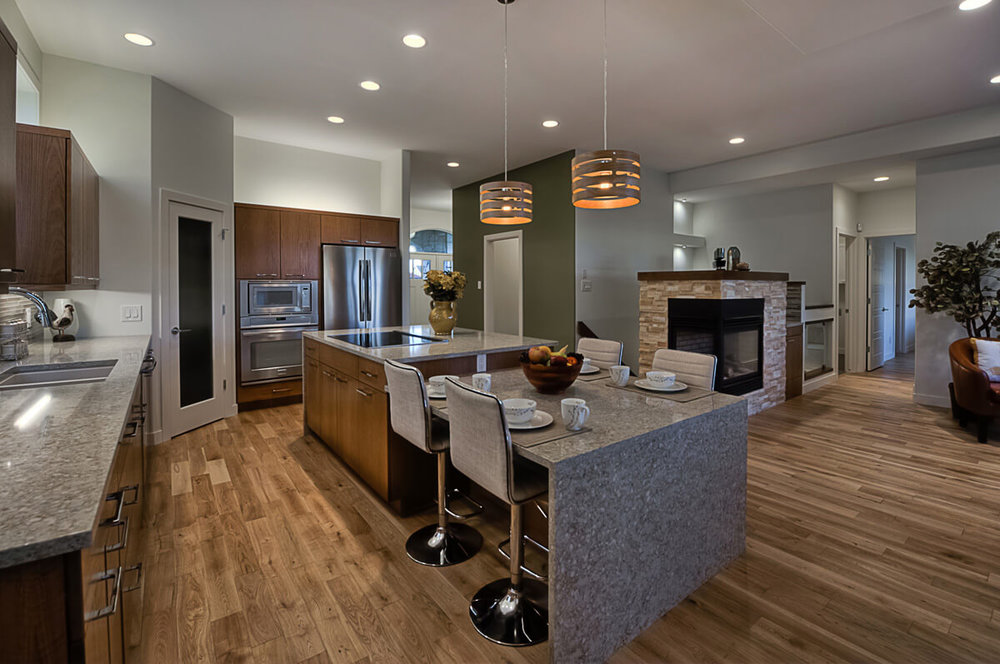 04-1630sqft_Hawksridge_Kitchen Island_Bungalow_Bridgwater Lakes.jpg