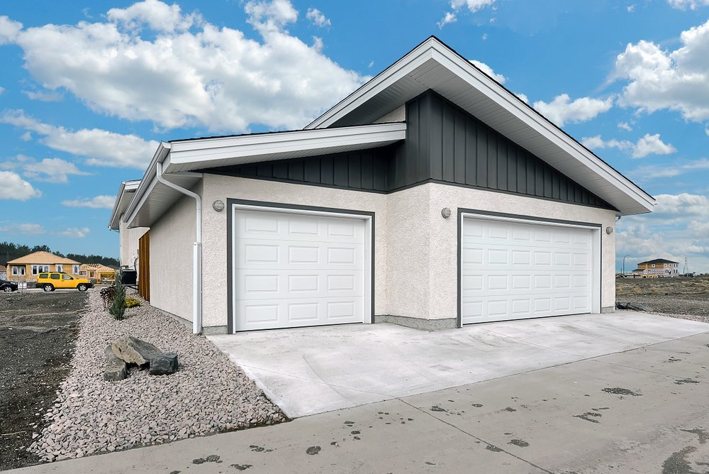 lo-res-7-water-lily-exterior-triple-car-garage.jpg