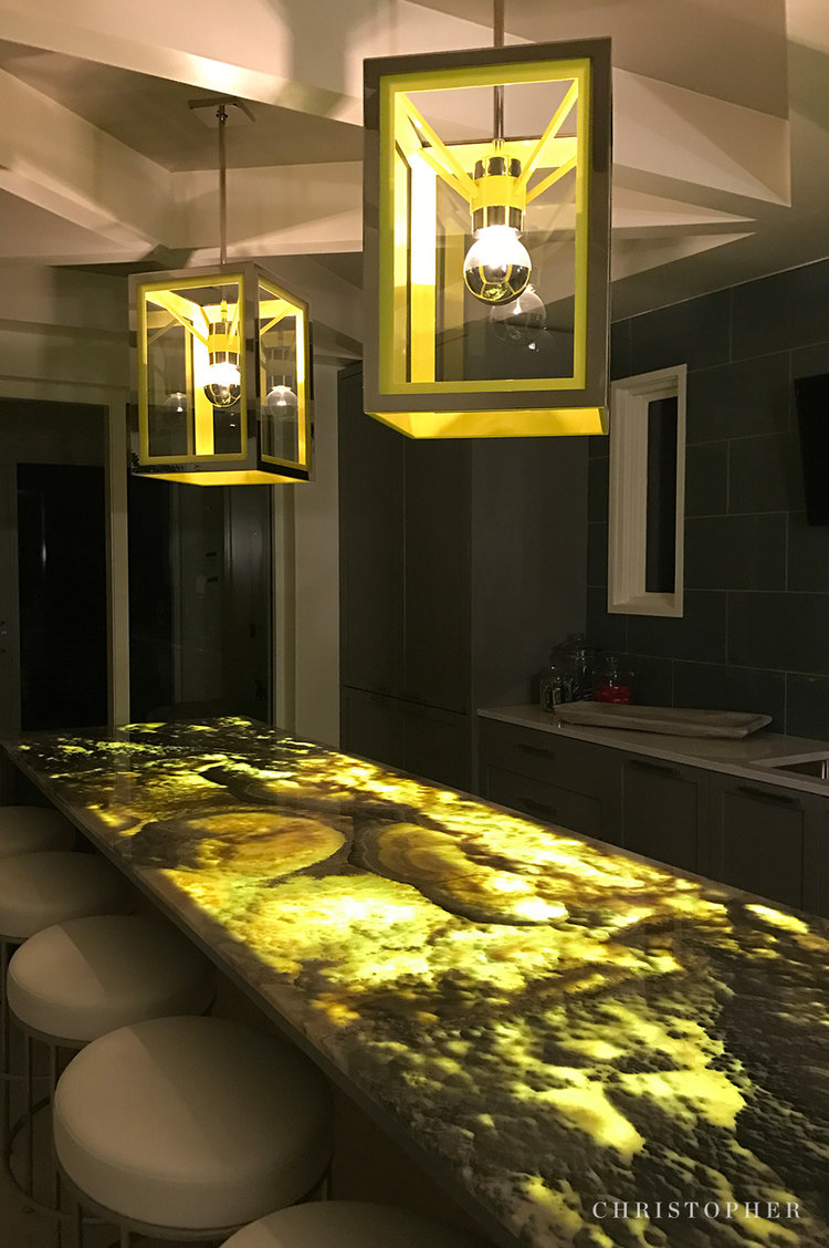 Coastal Luxury-waterfall island + custom lighting.jpg