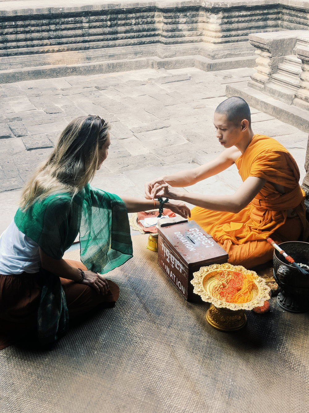 Blessed by a monk at Angkor Wat