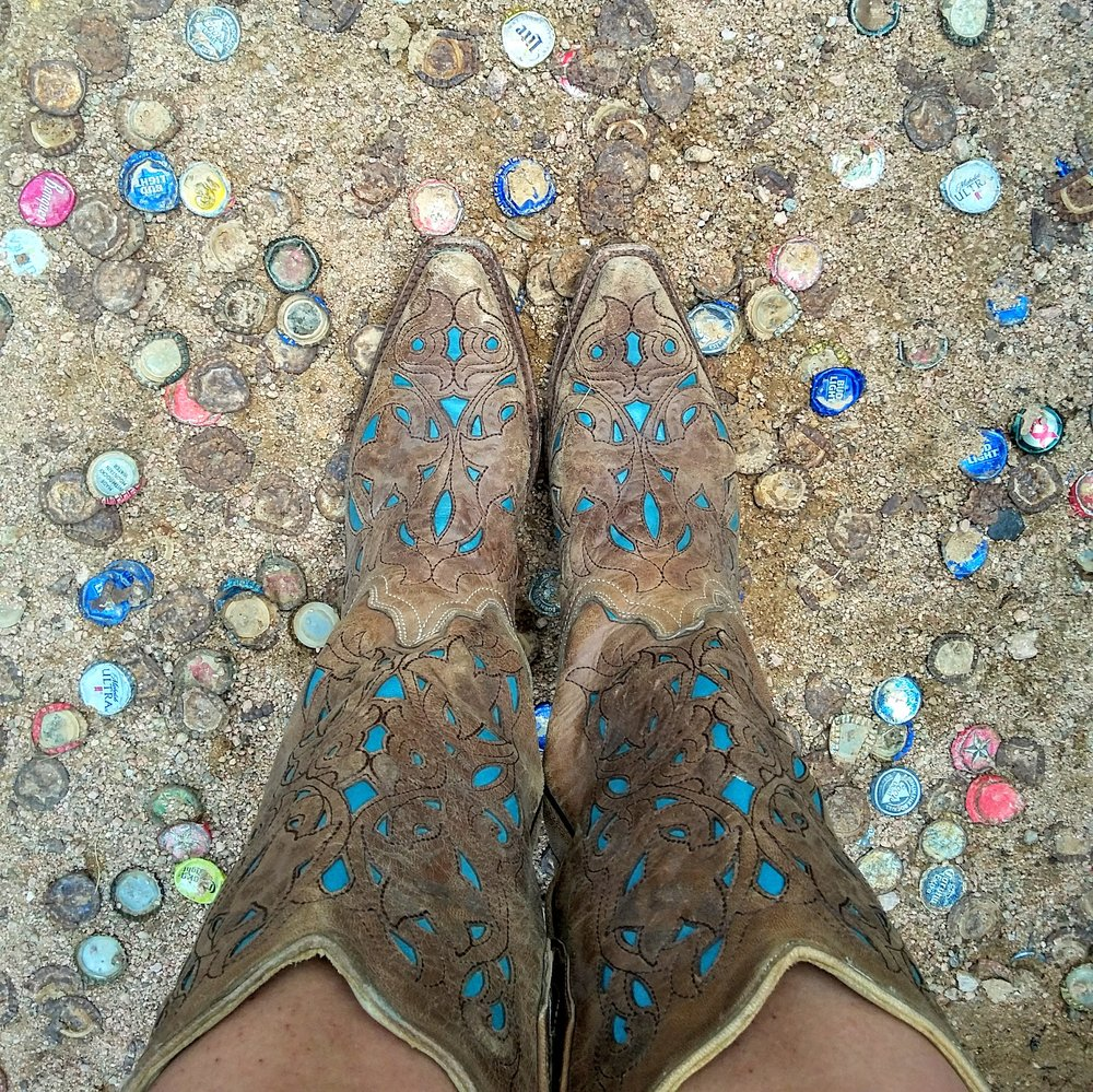 Daisy & Buck (DJ EPSR & Missy Martinez) Cowgirl boots and cold LoneStar Beer at Harry's on the Loop.  Willow City, Tx. Texas Hill Country Road Trip. August 2017.