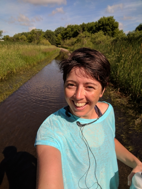 Nope, that's not a river behind me; it's the bike path! It rained pretty hard last night so this is what happened. Lots of red-winged blackbirds flitted around the cattails on both sides of the path as I ran by.