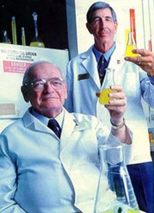 Dr. J. Robert Cade, left, with Dr. James Free, who helped Cade create Gatorade.  Photograph courtesy of Bloomberg.