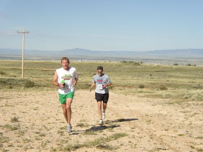 Brian Martisius and Patrick Eastman run toward the middle aid station at a blistering pace.