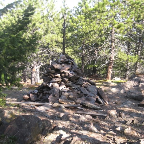 No views from the summit, but the cairn is pretty huge.