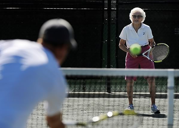 100-year-old Louise Donner at the Pinehurst Country Club, where she plays tennis with pro Marshall Carpenter twice a week on the clay court.  Photo by Cyrus McCrimmon, The Denver Post.