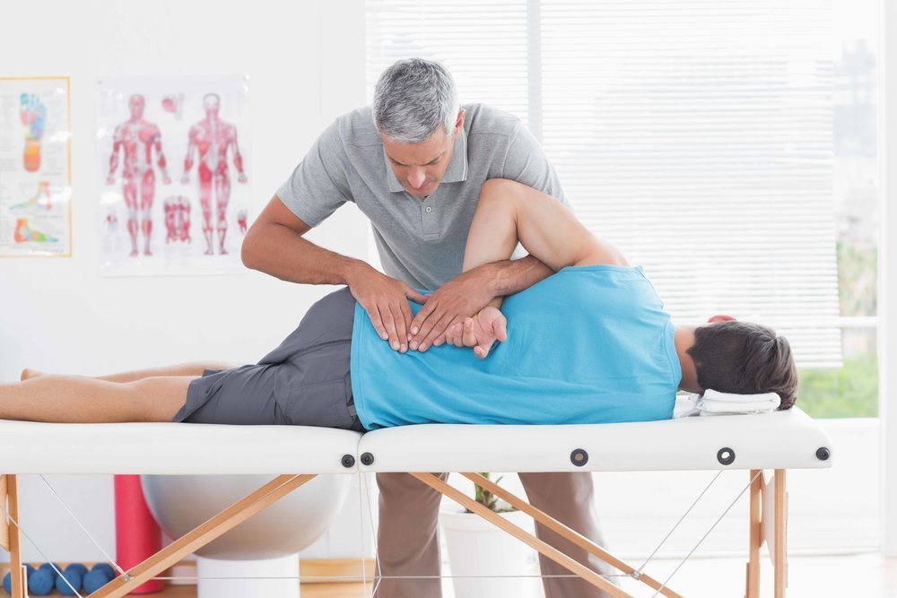 Patient Being adjusted by a chiropractor at Pearson Family Chiropractic in Palm Coast, FL USA