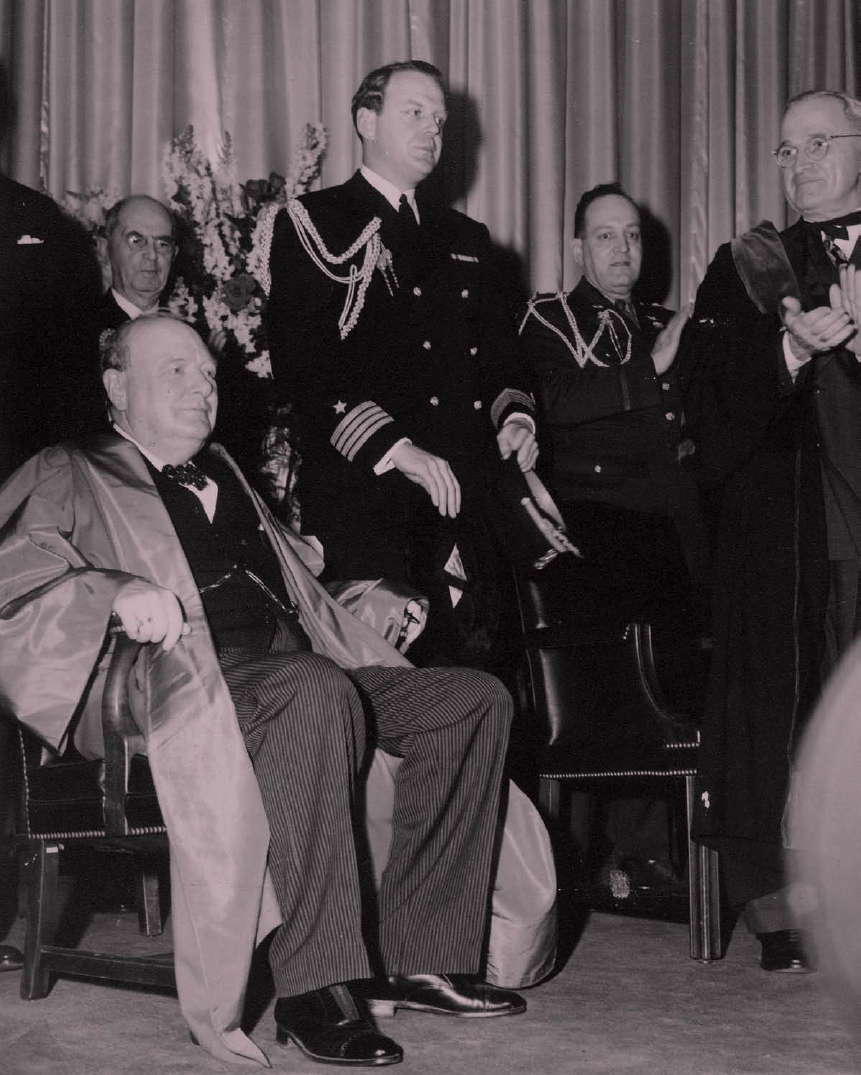 """On March 5, 1946, Winston Churchill received an honorary degree from Westminster College in Missouri and delivered his famous """"iron curtain"""" speech, announcing that an """"iron curtain"""" was now dividing Europe between communist controlled and free countries. President Truman (on right) traveled with Churchill to the ceremony."""