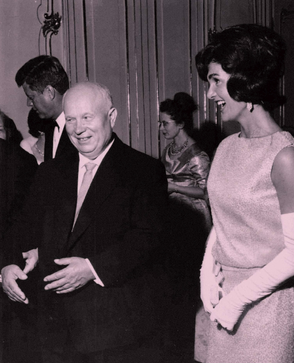 During the gala dinner at Schönbrunn Palace, Chairman Nikita Khrushchev chatted with American First Lady Jackie Kennedy, with President Kennedy in the background (on left).